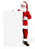 Smiling Santa Claus holding a white board Stock Photography