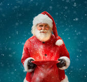 Smiling Santa Claus with open sack and looking at camera. Stock Images