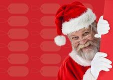 Smiling santa claus peeking from behind the wall Stock Photo