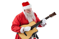 Smiling santa claus playing a guitar Stock Photos