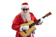 Smiling santa claus playing a guitar Stock Photography