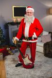 Smiling santa claus standing with a guitar Stock Photography