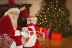 Smiling santa claus stocking gifts Royalty Free Stock Photo