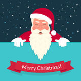 Smiling Santa Claus wearing red hat and glasses Stock Photos
