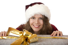 Smiling Santa Claus Woman with Christmas gift Royalty Free Stock Images