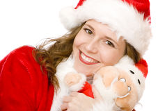 Smiling Santa Claus woman holding Santa Claus doll Royalty Free Stock Photos