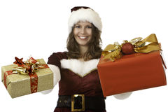 Smiling santa claus woman holds Christmas gift Stock Photos