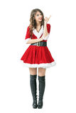 Smiling Santa Claus woman scolding finger looking at camera. Full body length portrait isolated over white studio background Stock Photography