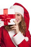 Smiling Santa emerge from behind a gift box Royalty Free Stock Images