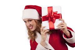 Smiling Santa emerge from behind a gift box Royalty Free Stock Photo