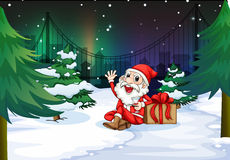 A smiling Santa beside the gift Royalty Free Stock Photo