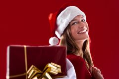 Smiling Santa Girl with gifts Stock Images