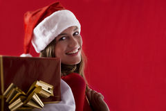 Smiling Santa Girl with gifts Royalty Free Stock Images