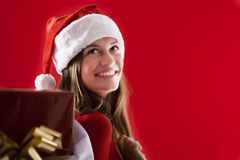 Smiling Santa Girl with gifts Royalty Free Stock Photos