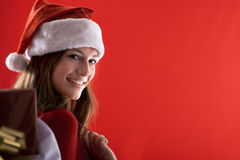 Smiling Santa Girl with gifts Stock Photo