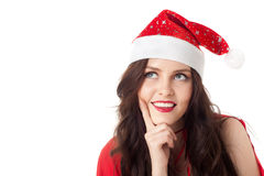 Smiling santa girl looking on copyspace Stock Images
