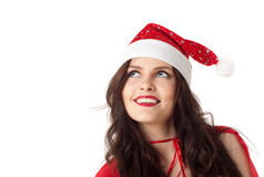 Smiling santa girl looking on copyspace Stock Photos