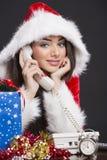 Smiling Santa girl on the phone royalty free stock photo