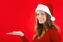 Smiling Santa Girl Showing Royalty Free Stock Image