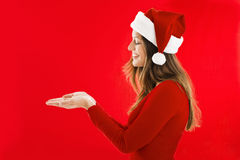 Smiling Santa Girl showing Royalty Free Stock Image