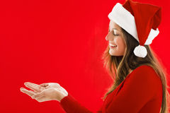 Smiling Santa Girl showing Stock Photo