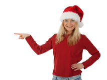Smiling Santa girl showing direction Royalty Free Stock Image