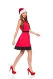 Smiling santa girl walking Royalty Free Stock Images