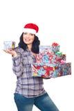 Smiling santa helper hold Christmas presents Royalty Free Stock Photos