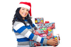 Smiling Santa helper holding several  gifts Stock Photos