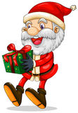 A smiling Santa holding a present for Christmas Royalty Free Stock Image