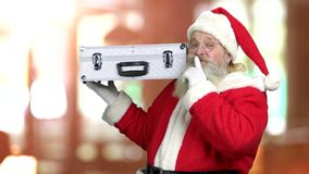 Smiling Santa holding silver case. stock footage