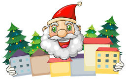 A smiling Santa hugging the village Royalty Free Stock Photo
