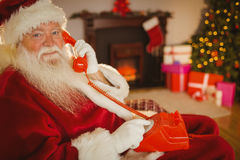 Smiling santa making a phone call Stock Images