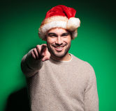 Smiling santa man is pointing finger Stock Image