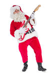 Smiling santa playing electric guitar Stock Images