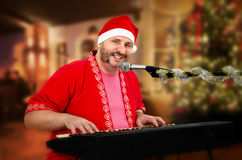 Smiling Santa singing Christmas songs Royalty Free Stock Photography