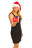 Smiling Santa woman giving gift Stock Photography