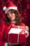 Smiling Santa Woman Opening a Present Royalty Free Stock Images