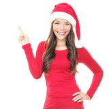 Smiling santa woman pointing up. Beautiful smiling christmas santa woman pointing up showing copyspace. Isolated on white background Royalty Free Stock Images