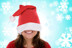 Smiling santa woman in red with blue background Royalty Free Stock Photography
