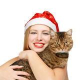 Smiling santa woman with tabby cat Stock Image
