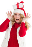 Smiling santa young woman with gift on her head Royalty Free Stock Images