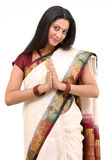 Smiling sari with welcome posture Stock Image