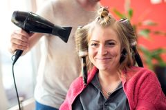 Smiling satisfied customer at beauty salon. Ready for new hair stylist stock image
