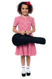 Smiling school girl with guitar Royalty Free Stock Images