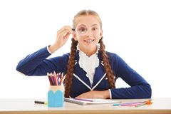 Smiling school girl with loupe Royalty Free Stock Photos