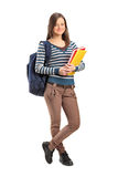 Smiling school girl posing with her books Royalty Free Stock Image