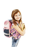 Smiling school girl with rucksack holding books Stock Photo