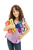 Smiling school girl with rucksack holding books Royalty Free Stock Image