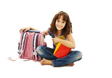 Smiling school girl with rucksack holding books Royalty Free Stock Photography